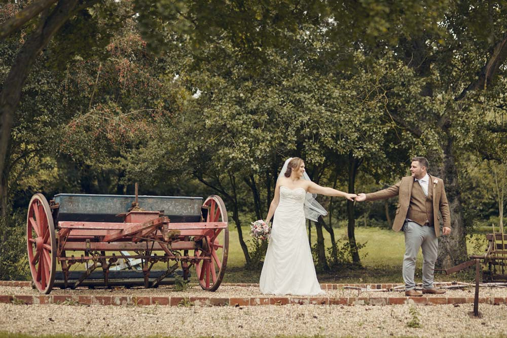 Vintage Farm Machinery with bride and groom, Tudor Barn, Belstead Wedding - www.helloromance.co.uk