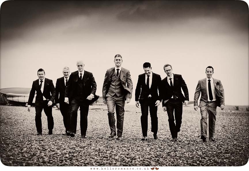 Groom and groomsmen on Dunwich Beach Suffolk - Westleton Crown Wedding Photography - Kate and Rob - Hello Romance Wedding Photography Suffolk