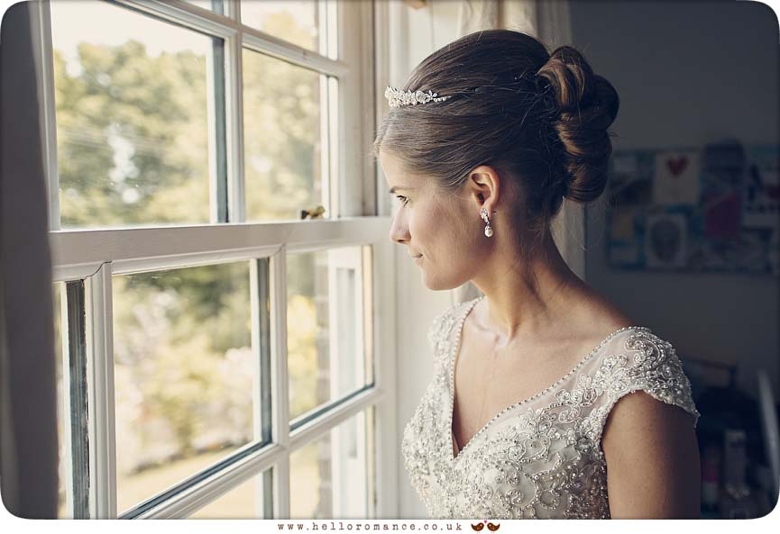 Bride looking out of window - www.helloromance.co.uk