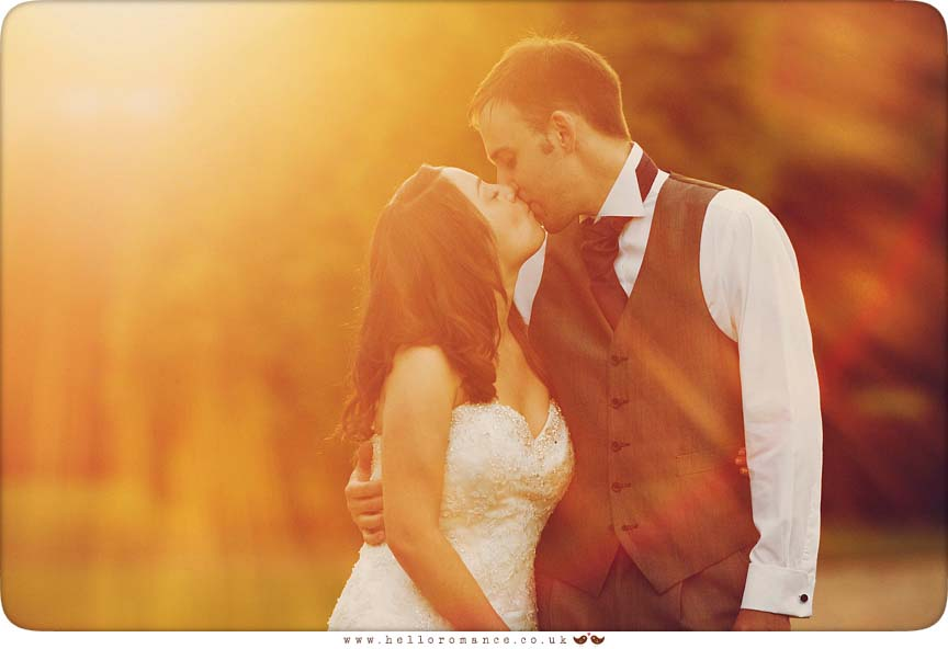 Sun Flare Bride and Groom kissing at Haughley Park Barns Suffolk Unique Vintage wedding photography - Hello Romance Wedding Photography
