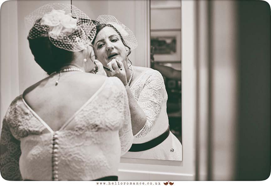 Bride looking in mirror at Essex wedding - www.helloromance.co.uk
