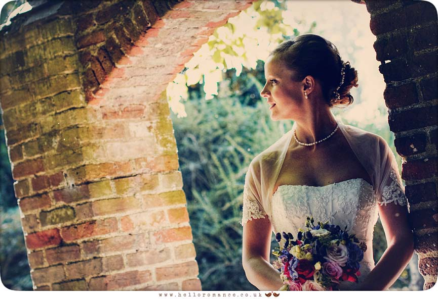 Bride portrait, bride looking over shoulder at Haughley Park Barns Suffolk Unique Vintage wedding photography - Hello Romance Wedding Photography