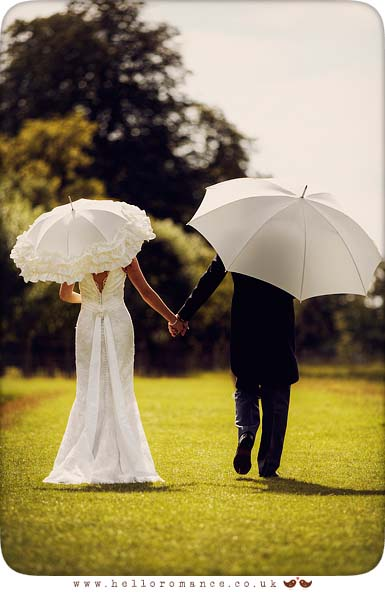 Bride and Groom with umbrellas at Helmingham Hall Wedding Photography - Katie and Greg - Hello Romance Wedding Photography Ipswich Suffolk