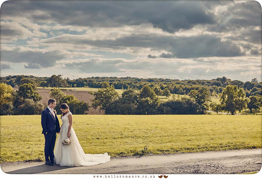 Stunning scene behind bride and groom with moody sky - www.helloromance.co.uk