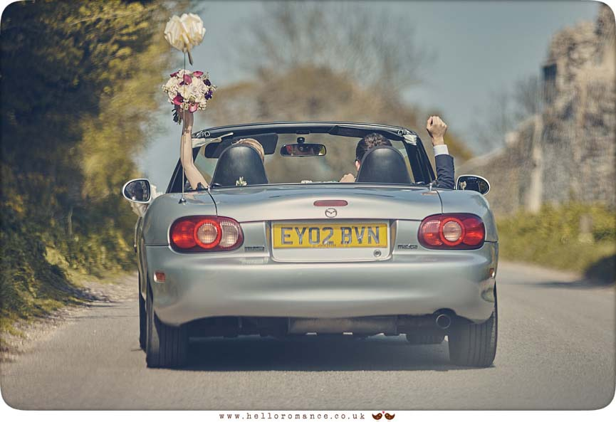 Cool photo of bride and groom in sports car Mazda MX5 - www.helloromance.co.uk
