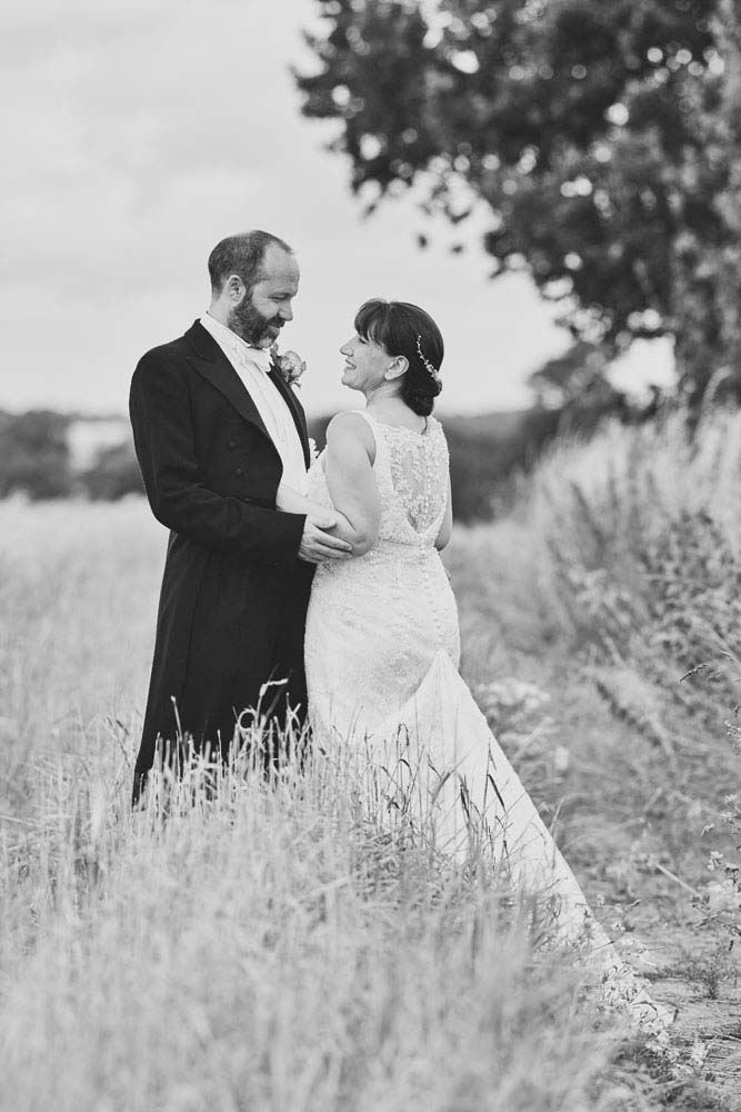 Romantic walk with bride and groom at Stoke-by-nayland - www.helloromance.co.uk