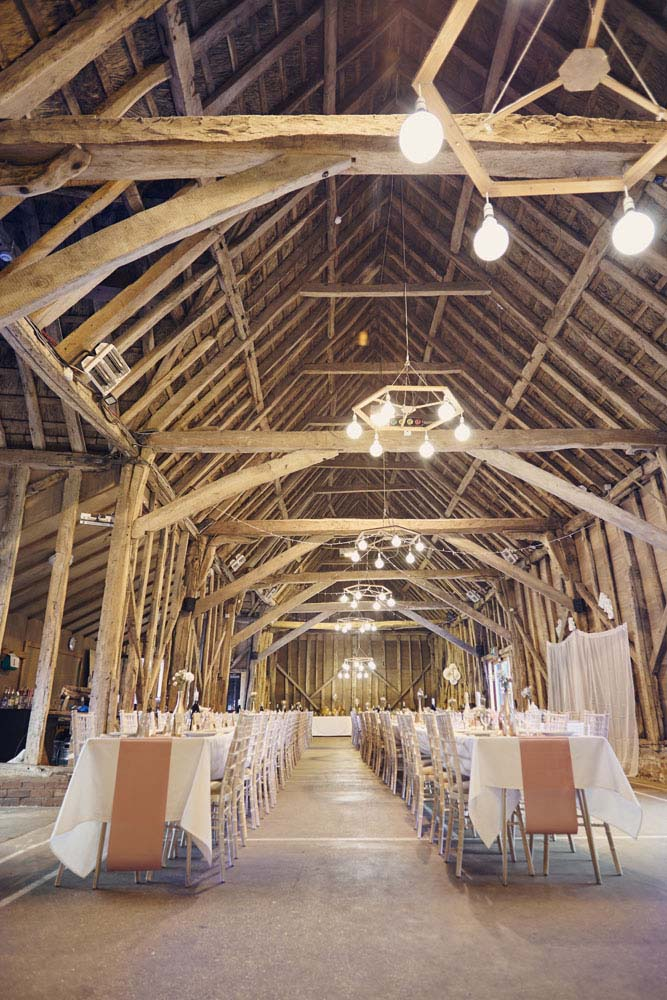 Wedding tables set-up Inside Sproughton Tithe Barn, Suffolk Wedding photography - www.helloromance.co.uk