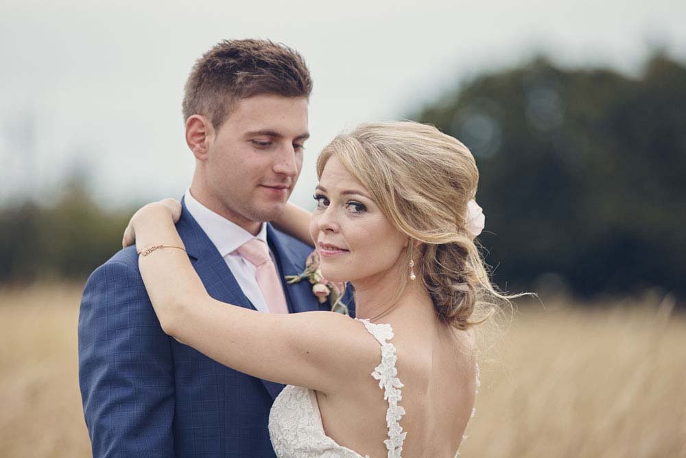 gorgeous shot of bride looking over shoulder at Sproughton, suffolk wedding - www.helloromance.co.uk