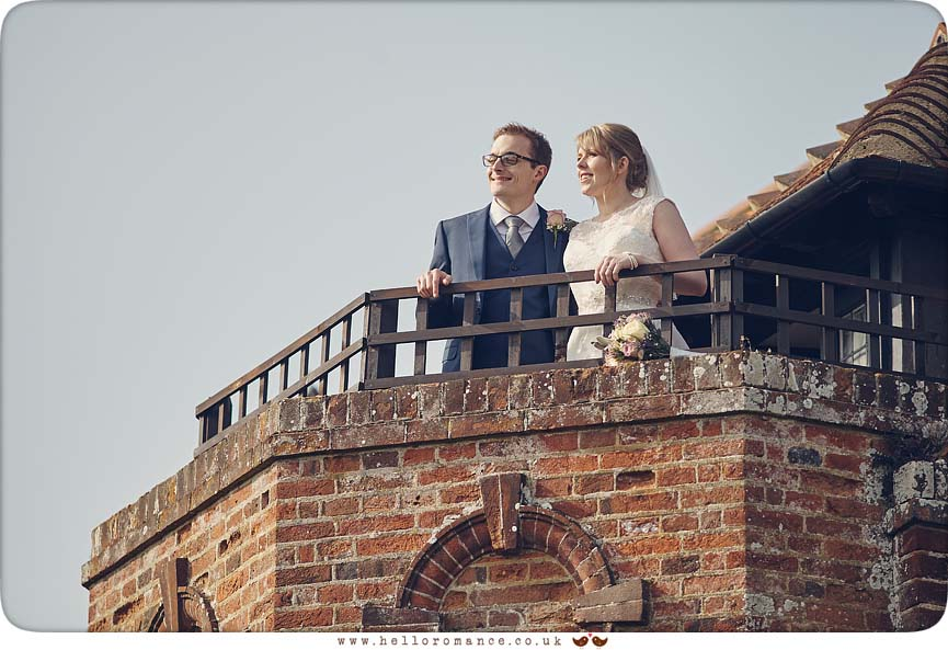 Bride and Groom on Balcony at Woodhall Manor - www.helloromance.co.uk