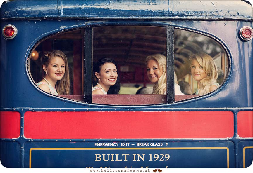 Bridesmaids looking out of the back of vintage bus - www.helloromance.co.uk