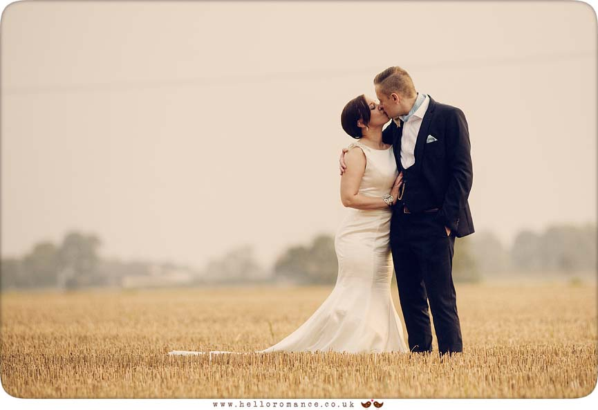Kiss in field at sunset (Wedding photography from Eye, Suffolk) - www.helloromance.co.uk