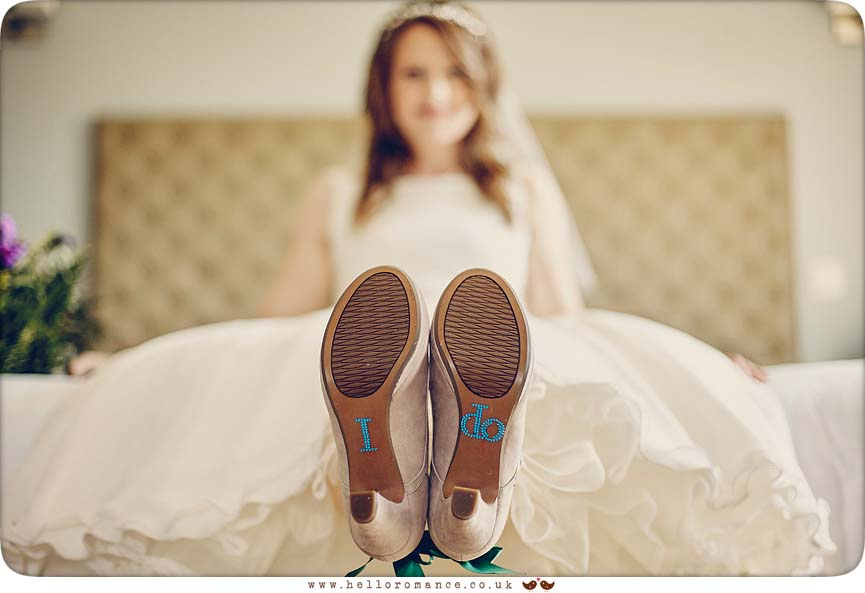 Cool shot of bride's shoes at wedding in Essex - www.helloromance.co.uk