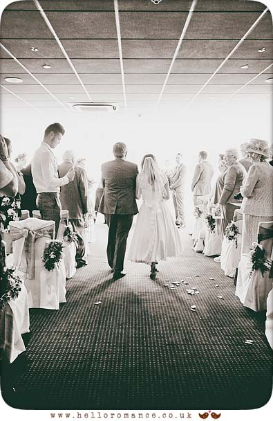 Walking down the aisle at Stoke By Nayland Golf Club - www.helloromance.co.uk