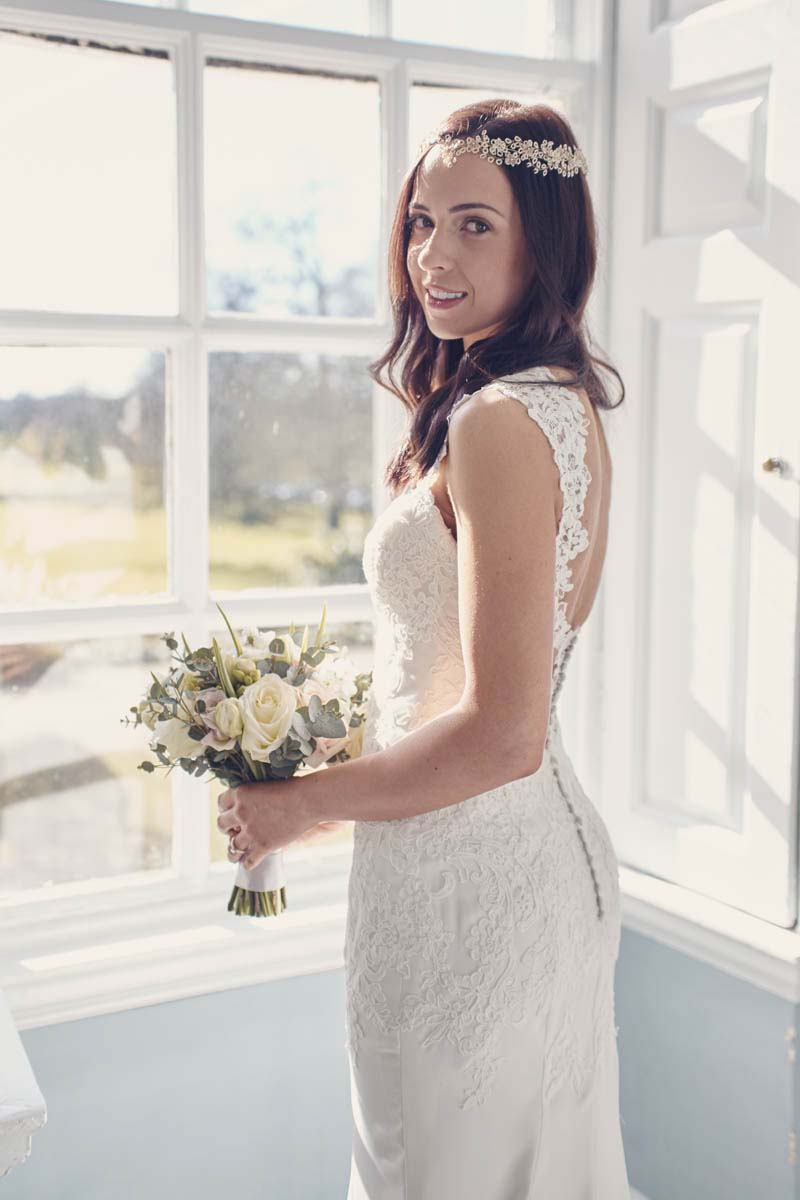 Bridal portrait with beautiful wedding dress at Hintlesham Hall - www.helloromance.co.uk