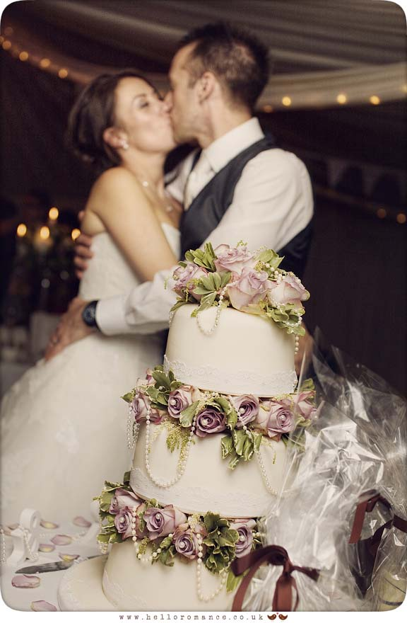 Kiss over Wedding Cake - Hello Romance Wedding Photography Suffolk