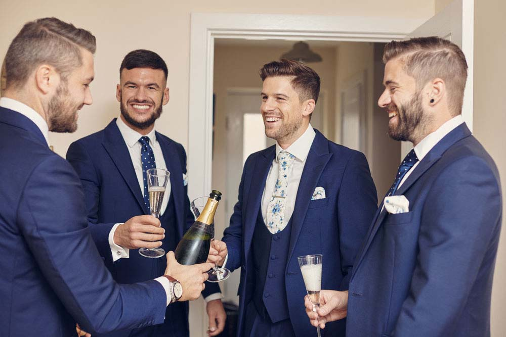 wedding lads, groom and ushers with champagne - www.helloromance.co.uk