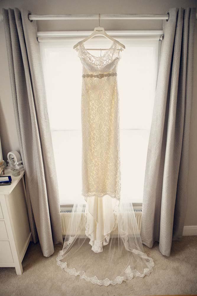 Bride's dress hanging up before wedding - www.helloromance.co.uk