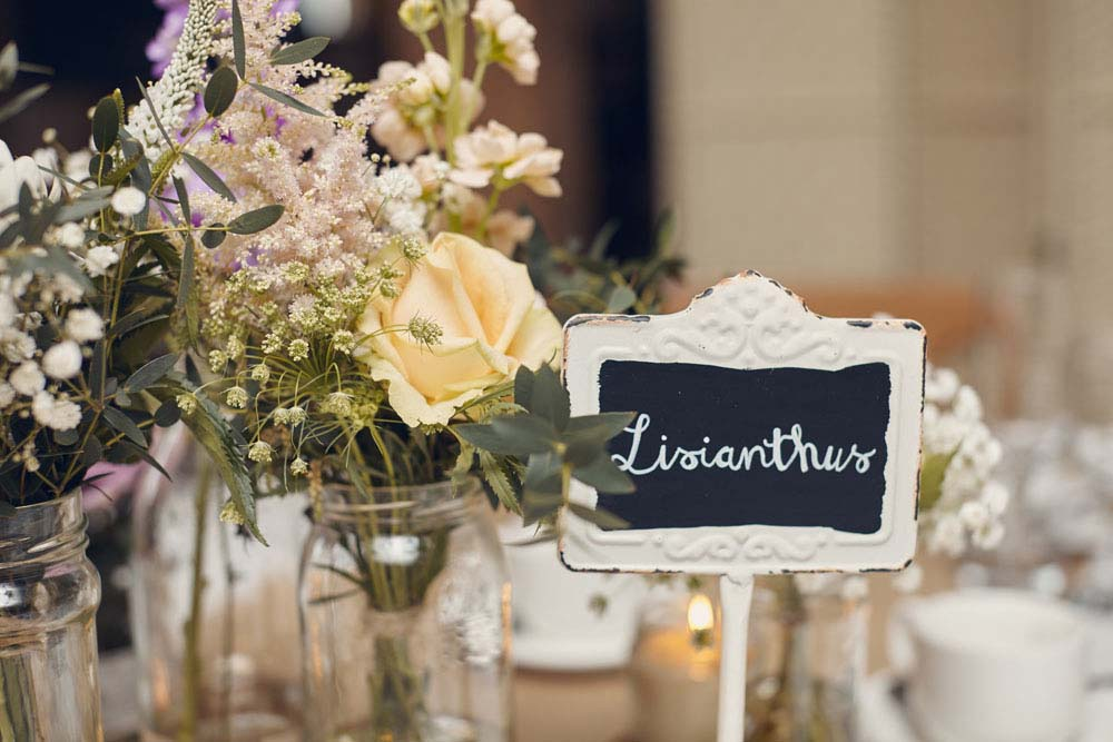 beautiful table decorations at wedding at Moreves Barn - www.helloromance.co.uk
