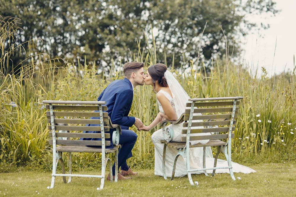 cute kissing photo, bride and groom at Moreves Barn in Sudbury Suffolk - www.helloromance.co.uk