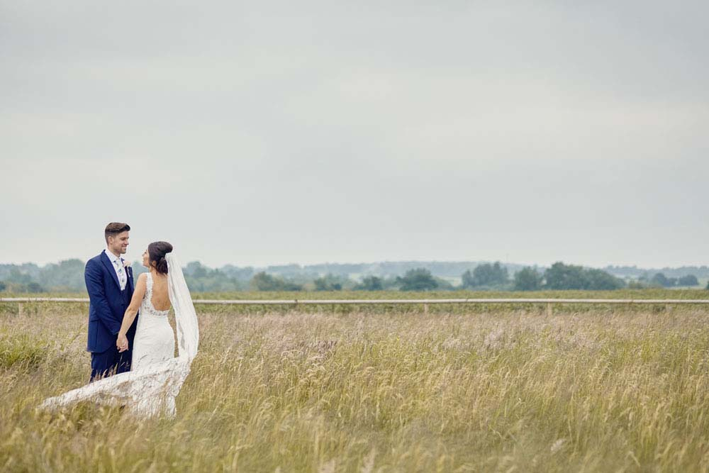 Bride and groom, gorgous photo in meadow at Moreves Barn in Sudbury Suffolk - www.helloromance.co.uk