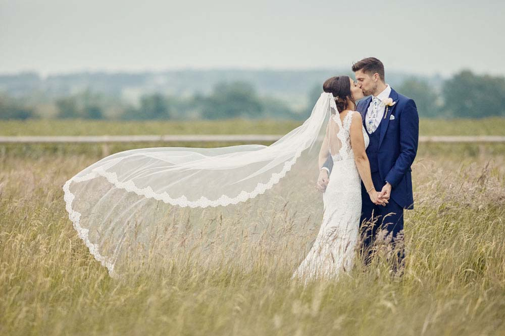 veil being blown in the wind at Moreves Barn in Sudbury Suffolk - www.helloromance.co.uk