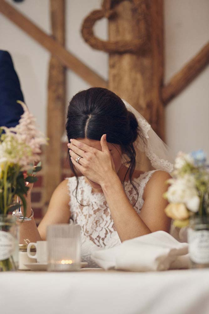bride embarrassed at Moreves Barn in Sudbury Suffolk - www.helloromance.co.uk