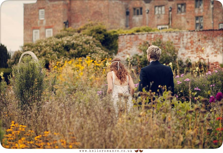 Bride and Groom Walking through Flowers, Glemham Hall Wedding Photography Suffolk - Hello Romance
