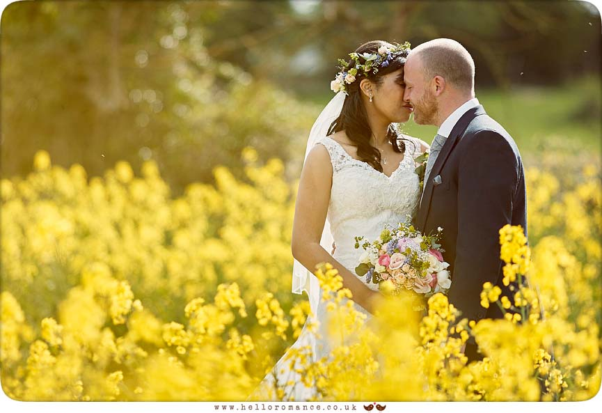 Wedding Photos in Oilseed Rapeseed field, kissing - www.helloromance.co.uk