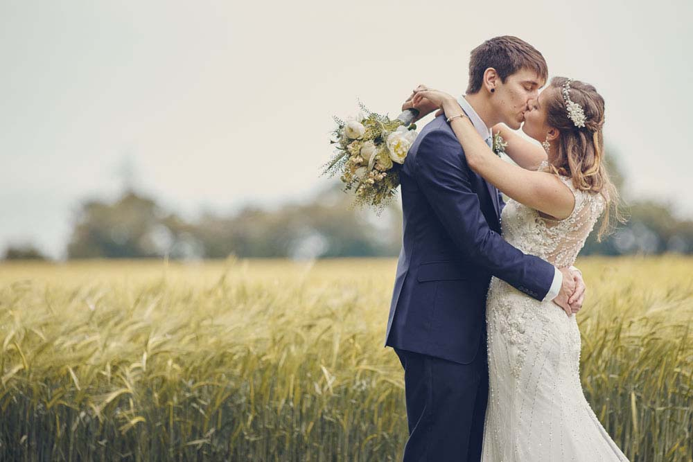 Wedding Kiss with field in Suffolk - www.helloromance.co.uk