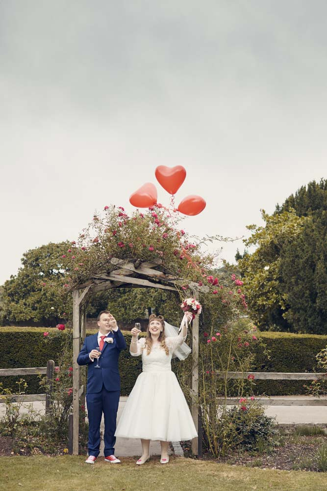 Prittlewell Priory Southend Wedding - Vintage bride and groom with balloons - www.helloromance.co.uk
