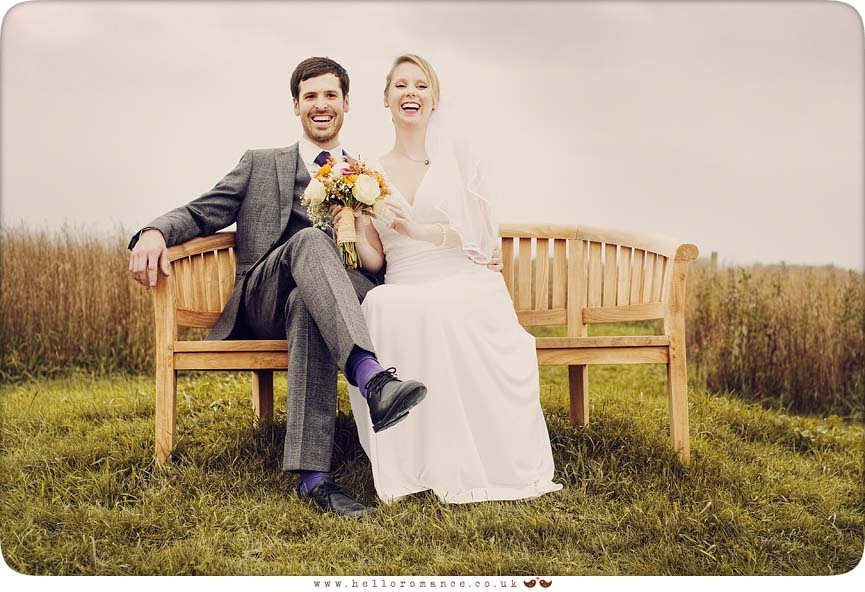 Bride and Groom on Bench - Alpheton Hall Barns - Hello Romance