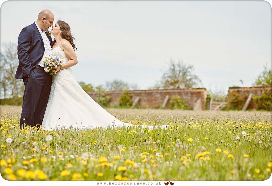 Bride and groom in meadow, Hawstead, Suffolk Barn - www.helloromance.co.uk