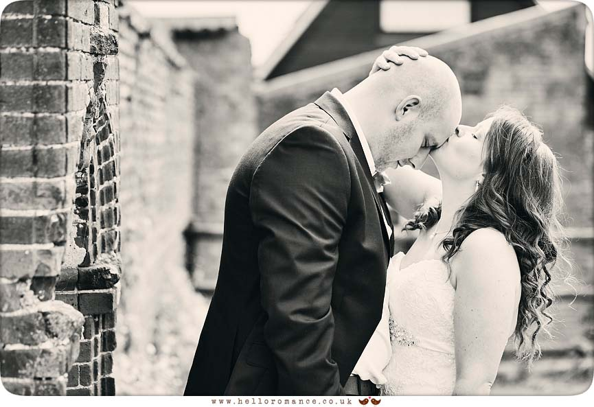 Black & White photo of bride kissing groom's head - www.helloromance.co.uk